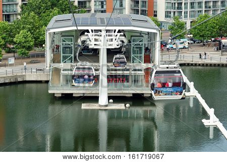 LONDON ENGLAND - JULY 7 2016: Emirates Air Line cable cars. The service is the UK's first urban cable car running across the Thames from the O2 to the Excel Center.