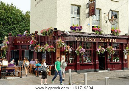 LONDON ENGLAND - JULY 7 2016: Grade I listed pub Gypsy moth - a public house in Greenwich.
