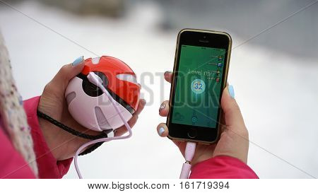 Samara, Russia - December 15, 2016: woman playing pokemon go on his iphone. pokemon go multiplayer game with elements of augmented reality. Level up 32.