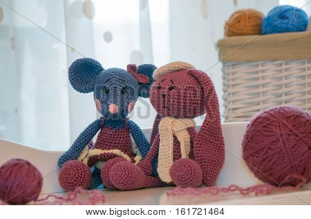 toys knitted hook, mouse and rabbit, ball of wool and spoke