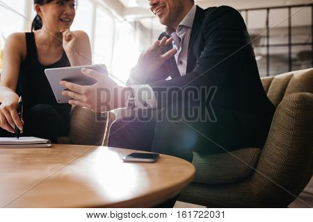 Business Partners Using Digital Tablet