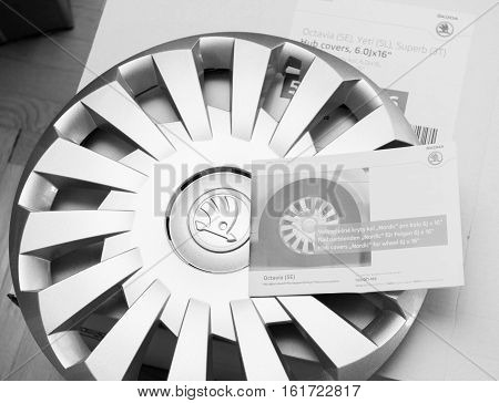 PARIS FRANCE - DEC 7 2016: Unpacking modern hub covers for the winter tyres made by Skoda Auto for Skoda Superb Skoda OCtavia and Skoda Roomster - online internet shopping black and white