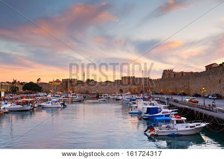 RHODES, GREECE - DECEMBER 05, 2016: Old harbor and city walls of the medieval town of Rhodes on December 05, 2016.