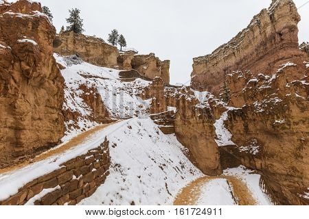 Wall Street trail with snow near Sunset Point in Bryce Canyon National Park in Southern Utah.