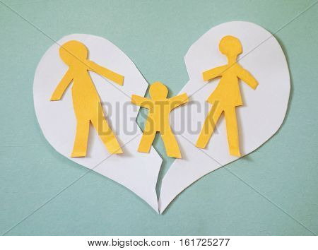 Paper family couple with child over a broken heart