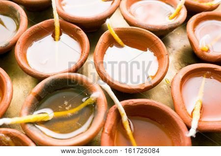 Indian earthenware lamps filled with oil and a cotton wick. These diyas are used to light up prayer areas and homes during the hindu festival of diwali