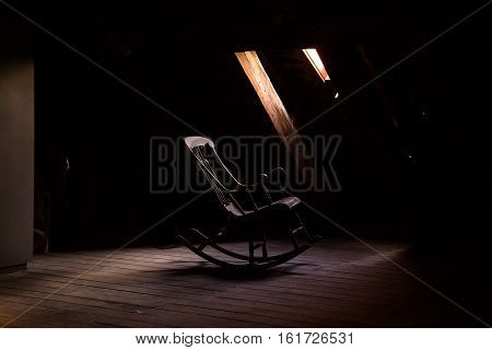 Lonely rocking chair at penthouse in a loft poster