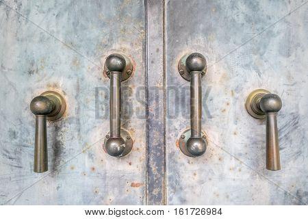 metal door with four vertical metal handles