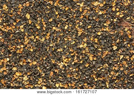 asphalt texture with black and orange grains