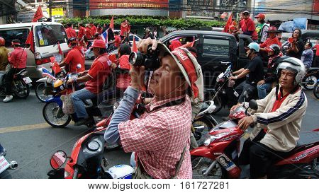 BANGKOK THAILAND - JANUARY 232011: photographer on the Red Shirt demonstration