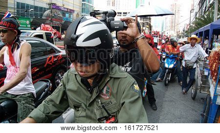 BANGKOK THAILAND - JANUARY 232011: Videographer on the Red Shirt demonstration