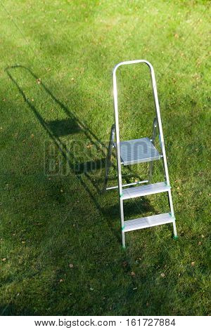 ladder on green lawn background