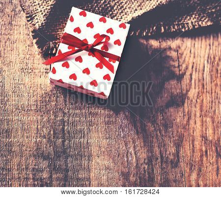 Valentines Day background with present gift on wooden background with blank copy space