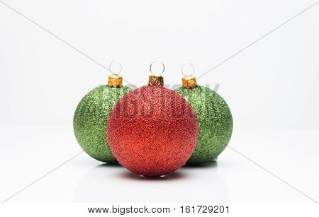Three christmas balls isolated on white background.