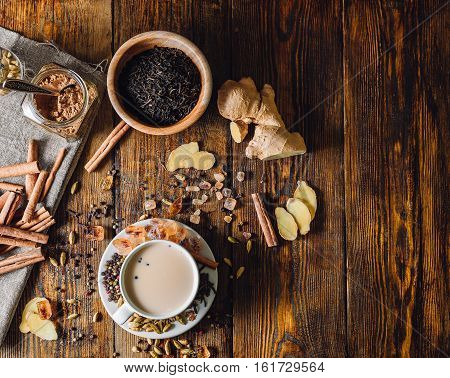 Ingredients for Masala Chai and Cup with Beverage. View from Above and Place for Text.