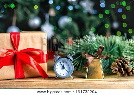 Christmas decoration red ball, baubles, handbells and antique clock on wooden background
