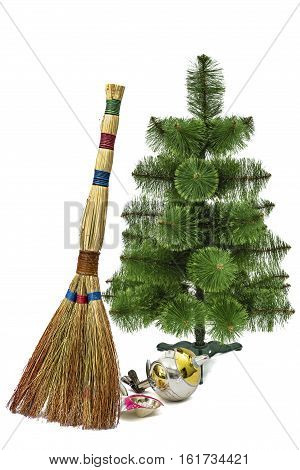 Balayage of broken Christmas decorations with the help of a besom on a Christmas tree background isolated on white