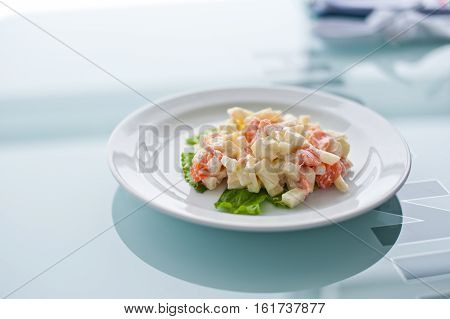 Fresh vegetable salad with corn, pepper, crab, cucumber, eggs and mayonnaise.