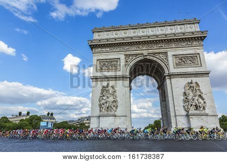 Paris France - July 24 2016: The peloton (including the major distinctive jerseys) passing by the Arch de Triomphe on Champs Elysees in Paris during the latest stage of Tour de France 2016.