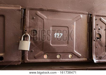 lock hangs on the box for mail iron box for mail with newspaper