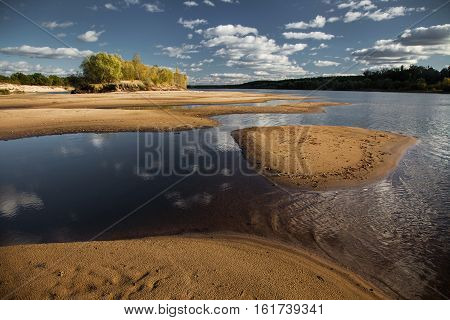 summer landscape on the river on a clear day the beautiful beach on the river Pripyat saver for your desktop calming view clouds in the blue sky over the river water beauty of nature Island