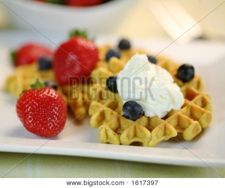 Delicious Waffles With Whip Cream And Fresh Berries
