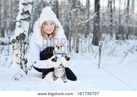 Girl Playing In A Winter Forest With  Dog Breed Chihuahua
