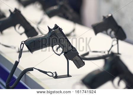 Different pistols models on store shelves. Weapon