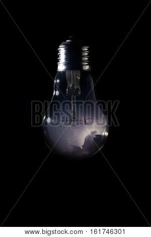 Thunder And Storm Inside Of Light Bulb On Dark Background