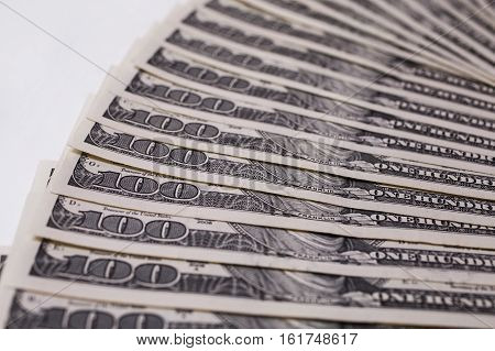 background of the money hundred dollar bills front side. background of dollars old hundred-dollar bil face fan from american dollars banknotes. Isolate on white.