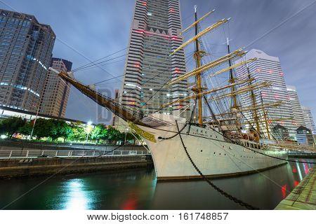 YOKOHAMA, JAPAN - NOVEMBER 6, 2016 : Nippon Maru sailing ship in Yokohama at night, Japan. Nippon Maru was built in 1930 as a training ship for the cadets of Japanese merchant marine.