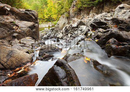 Water flowing at the Top of Split Rock Falls in the Adirondacks