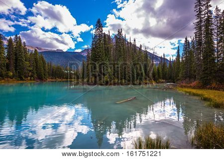 Mountain Emerald lake. Sunny day in autumn. The concept of eco-tourism and active recreation. Canada, Yoho National Park