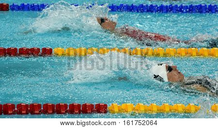 Hong Kong China - Oct 30 2016. Katinka HOSSZU (HUN) and HANUS Danielle (CAN) swimming in the Women's Backstroke 100m Preliminary Heat. FINA Swimming World Cup Victoria Park Swimming Pool.