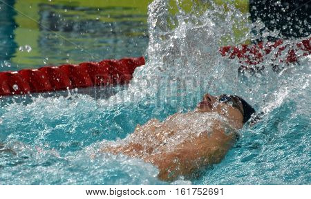 Hong Kong China - Oct 30 2016. Competitive swimmer SANKOVICH Pavel (BLR) swimming in the Men's Backstroke 50m Preliminary Heat. FINA Swimming World Cup Victoria Park.