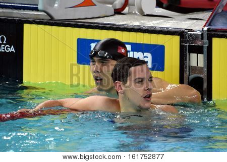 Hong Kong China - Oct 30 2016. Mitch LARKIN (AUS) and CHUNG Lai Yeung (HKG) after the Men's Backstroke 50m Preliminary Heat. FINA Swimming World Cup Victoria Park.