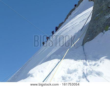 Climbers ascending the Petite Aiguilles Verte, Chamonix