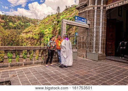Ipiales Ecuador - 11 September 2016: Religious Couple Is Confessing To A Priest At Las Lajas Sanctuary A Basilica Church Located In The Southern Colombia South America