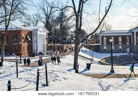 Charlottesville, USA - January 24 2013: Students of the Univeristy of Virginia walk to and from class on campus grounds during winter snow