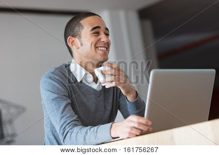 Happy Handsome Young Businessman Laughing