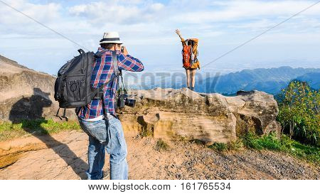 Photographer Taking Portraits  Standing With Arms Wide Open In View Precipice.