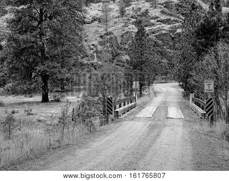 A bridge crossing over Mill Creek on the dirt backroad to Steins Pillar in the Ochoco National Forest in Central Oregon on a fall day.