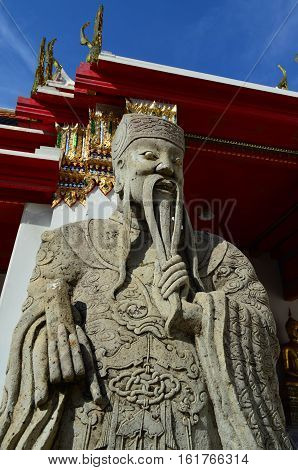 Stone sculpture of Chinese guardian at the entrance of Thai Temple Wat Pho Bangkok Thailand