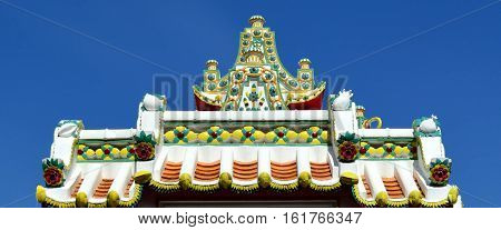 Vintage arch gable of Thai church temple decorate with colorful ceramic tiles Wat Pho Thailand