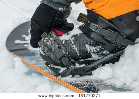 The Man In Black Boots Buttons Fastening Snowboard.