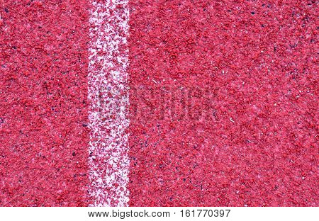 Red racetrack rubber texture with white stripe