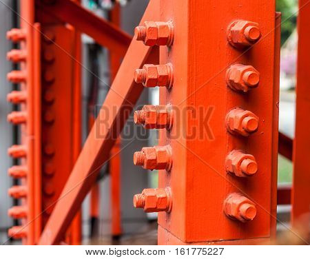Red bolts for mounting strength of steel structures.