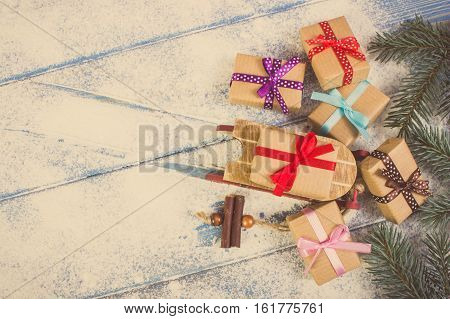 Spruce Branches And Wooden Sled With Wrapped Colorful Gifts For Christmas, Copy Space For Text