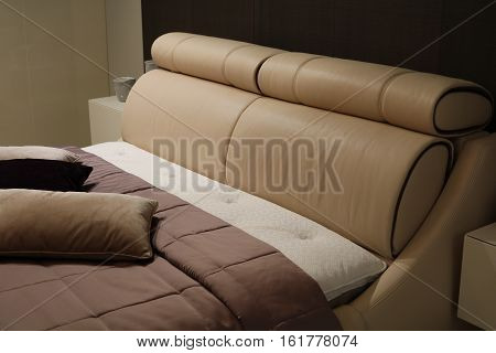 Bed with pillows in the bedroom interior