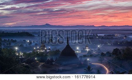 Sunset over pagodas of Mrauk-U in the mist at the northern Rakhine State Myanmar